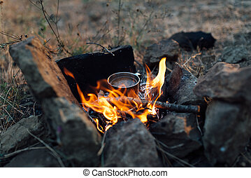 coffee cooked over a campfire on  nature