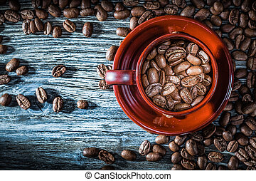 Coffee crops cup saucer on wooden board