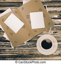 Coffee cup and album