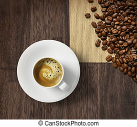 Coffee cup and beans on burlap