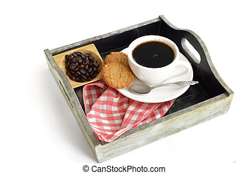 Coffee cup and beans with biscuit