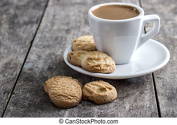 coffee cup and cookies on table