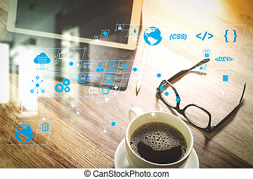 Coffee cup and Digital table dock smart keyboard, eyeglasses, stylus pen on wooden table, filter effect