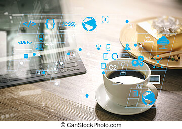 Coffee cup and Digital table dock smart keyboard, gold gift box and round wood tray, color pencil on wooden table, filter effect