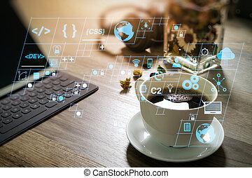 Coffee cup and Digital table dock smart keyboard, vase flower herbs, music headphone, eyeglasses on wooden table, filter effect