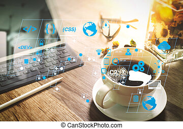 Coffee cup and Digital table dock smart keyboard, vase flower herbs, stylus pen on wooden table, filter effect
