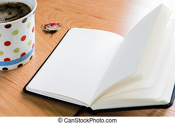 Coffee Cup And Notebook On Wooden Table With Copy Space