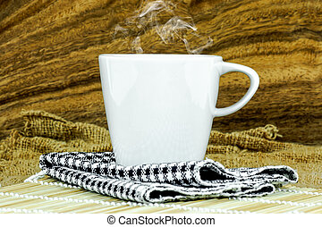Coffee cup and saucer on a wooden.