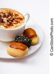 coffee cup and sweets assortment top view isolated