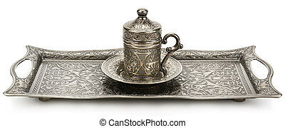 Coffee cup and tray with arabic decoration isolated on a white background. Wide photo.