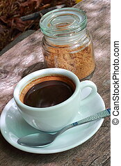 Coffee cup and white sugar