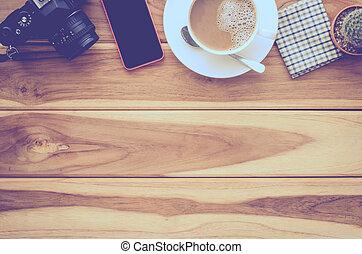 coffee cup, camera, smart phone on wood