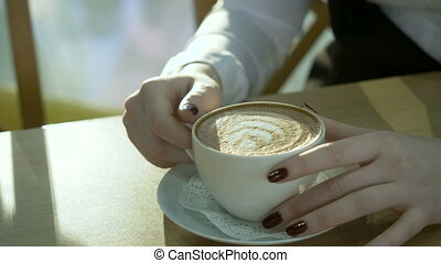 Coffee cup close-up. - Coffee close-up. Young woman sitting...