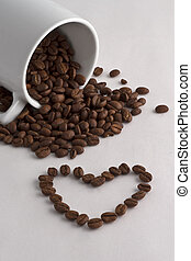 Coffee cup, coffee beans and heart