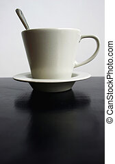 Coffee cup on black table
