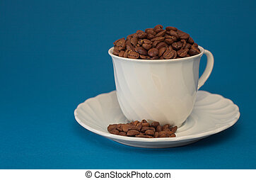 Coffee cup full of coffee beans