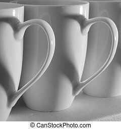 Coffee Cup Hearts - Three coffee cups with heart shaped...