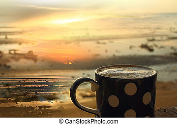Coffee cup in the morning on terrace with sunrise background