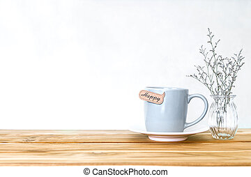 Coffee cup mug with happy word tag on wooden table , Romance and love background . Happy and relax concept