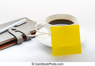 coffee cup, notebook on white background