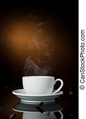 Coffee - cup of coffee on color background