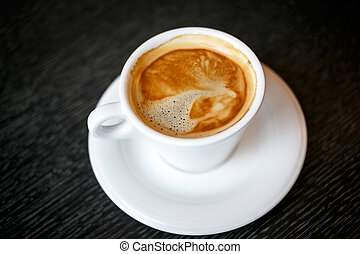 Coffee cup on a black background.