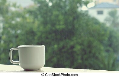 coffee cup on a rainy day background
