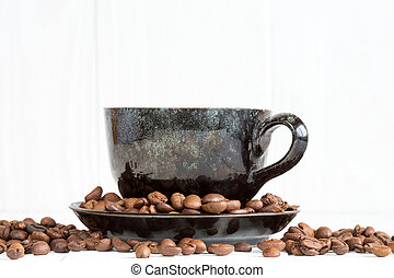 Coffee cup on a white background with coffee beans