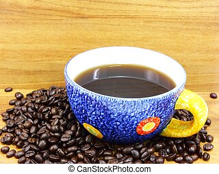 coffee cup on a wooden table dark background
