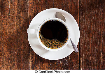 Coffee cup on dark wooden table