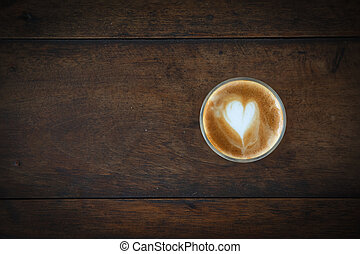 coffee cup on old wooden background, Top view