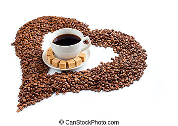 Coffee cup on pile of beans in form of heart isolated on white