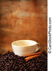 Coffee cup on roasted coffee beans