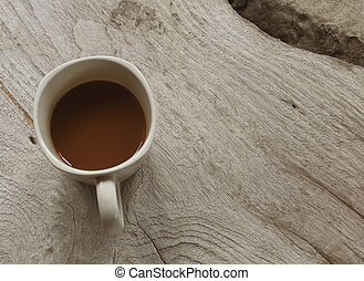 Coffee cup on wood background.
