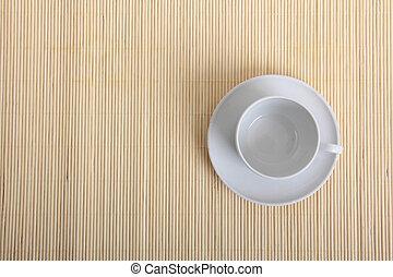 Coffee cup on wood