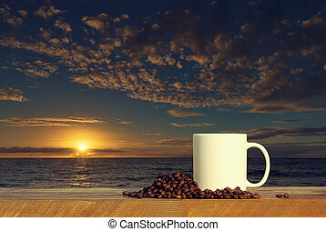 coffee cup on wood table at sunset