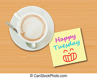 "Coffee cup on wood table with paper note ""Happy Tuesday"""