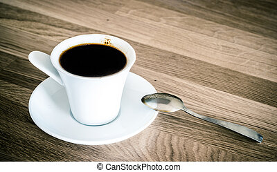 coffee-cup on wooden table