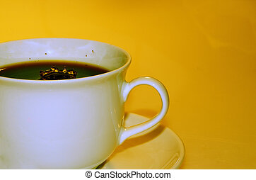 coffee cup on yellow