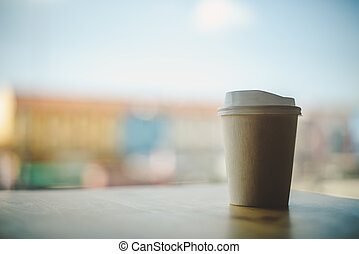 Coffee cup paper, background sky and city