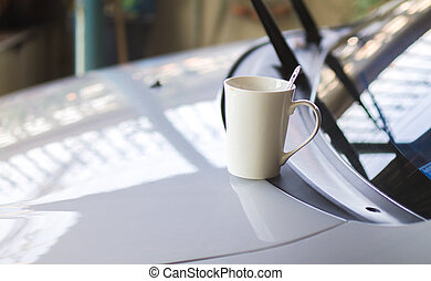 coffee cup put on front of car