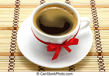 Coffee cup red bow on a wooden background