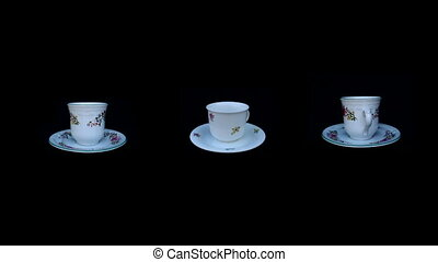 coffee cup rotation on isolated black