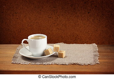 Coffee cup, saucer, sugar, napkin