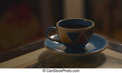 Coffee Cup Sitting on Small Plate - Handheld, interior,...