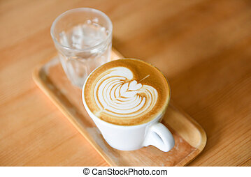 coffee cup top view - cappuccino latte art hot coffee on wooden table background