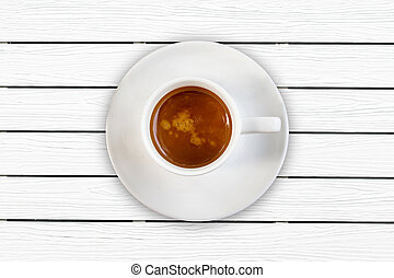 Coffee cup top view on white wooden