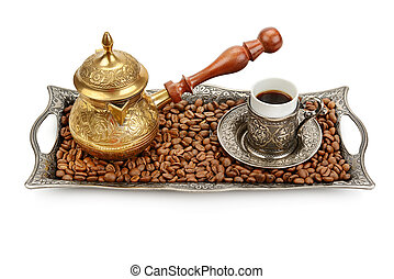 Coffee cup, tray with arabic decoration and coffeepot isolated on a white background.