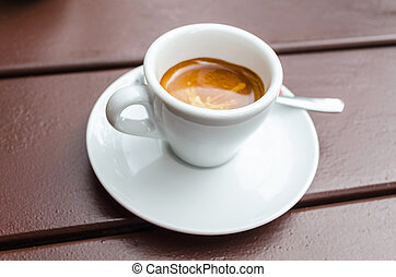 White coffee, espresso cup on a brown wooden table.