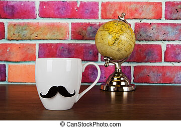 Coffee cup with a black hipster mustache